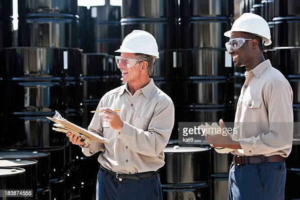 Manufacturing workers by steel drums