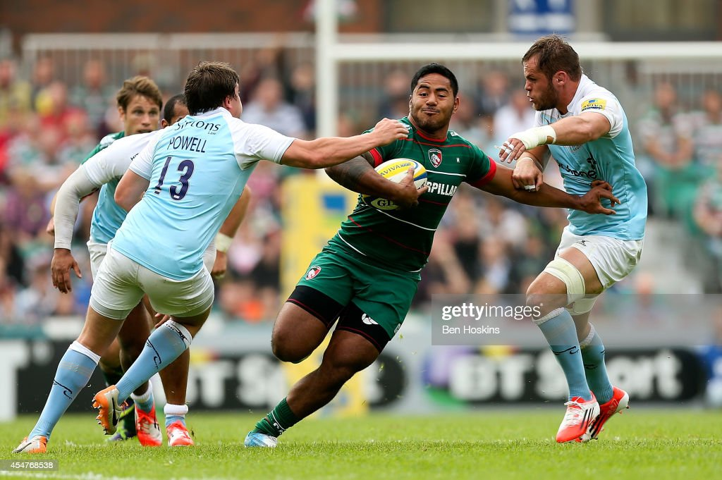Manusamoa Tuilagi of Leicester is tackled by Adam Powell (L) and Josh Furno (R) of Newcastle during the Aviva Premiership match between Leicester Tigers and Newcastle Falcons at Welford Road on September 6, 2014 in Leicester, England.