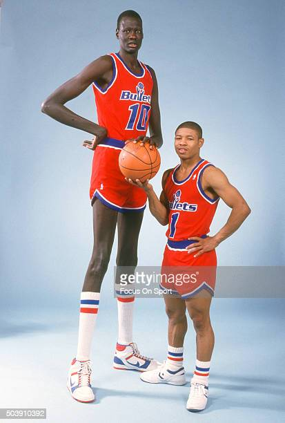 Manute Bol and Muggsy Bogues of the Washington Bullets poses together for this portrait circa 1987 at the Capital Centre in Landover Maryland Bol...