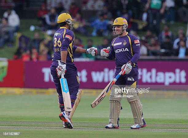 Manvinder Bisla and Brendon McCullum of the Kolkata Knight Riders celebrate during the Karbonn Smart CLT20 match between Kolkata Knight Riders and...