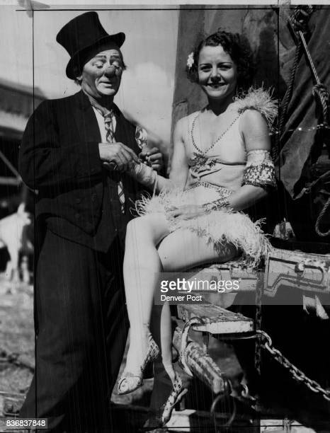 Many a Truth is spoken in jest Otto Greibling famous clown with the Cole brothers combined circus isn't just clowning as he tells pretty Helen...