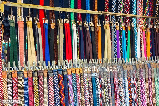 many belts of all types and colors : Stock Photo