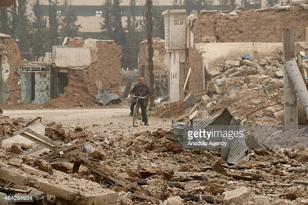 Many buildings are destroyed after Assad regime forces' barrel bomb attack hit the Syrian opposition controlled area in Daraa district of Aleppo...
