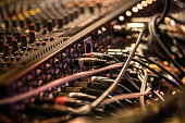 Many cables on the music recording mixer