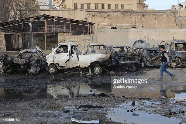 Many cars are destroyed during the air strikes by Syrian army warplanes on the ISILheld northern city of Raqqa Syria on November 25 2014 At least 130...
