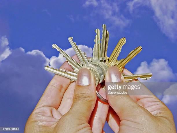Many Choices: Hand Holding Assortment of Keys