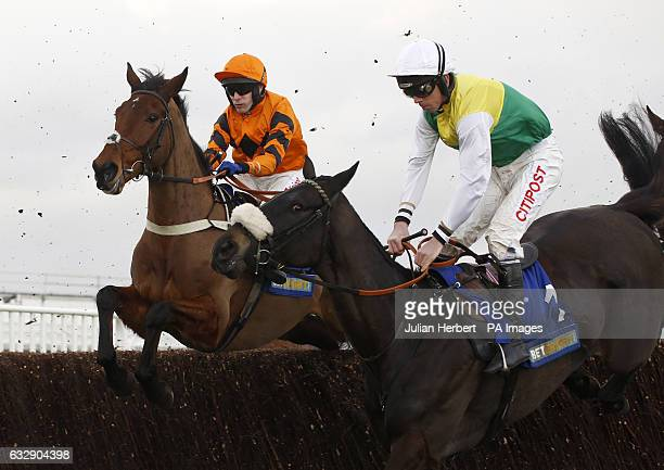 Many Clouds and Leighton Aspell jump an early fence in company with Thistlecrack ridden by Tom Scudamore before going on to win The Betbright Trial...