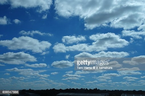 Many clouds in the blue sky