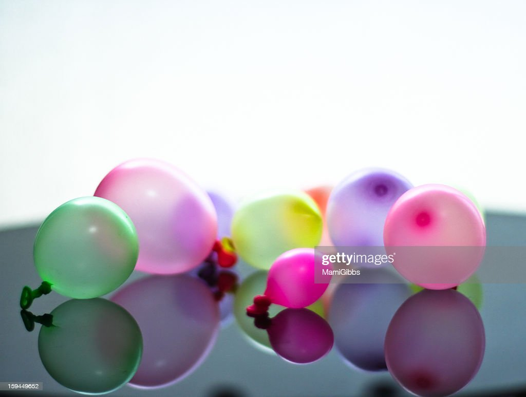 Many color small balloon on the table. : Stock Photo