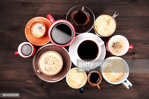 Many cups of coffee on wooden table : Stock Photo
