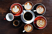 many cups of coffee on wooden background, top view. Ideas communication corporate concept