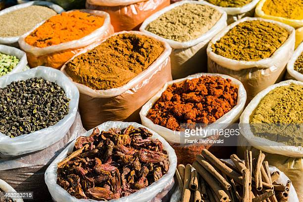 Many different goods like typical Indian spices and curries are presented in bags for sale at the weekly fleamarket