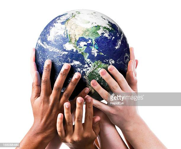 Many environmentally aware hands gently supporting the Earth.