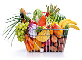 Market basket / studio photography of steel wire supermarket shopping carts basket with foodstuff - on white background