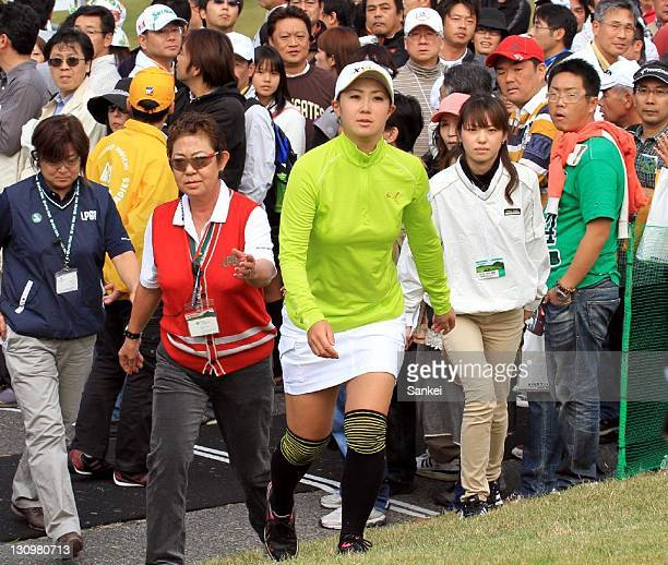 Many galleys follow Miho Koga during the second round of Weider Ladies 2011 at Morinaga Takataki Country Club on October 29 2011 in Ichihara Chiba...
