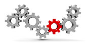 Many gears with red gear - concept of team cooperation or leadership, three-dimensional rendering, 3D illustration