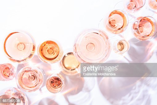 Many glasses of rose wine at wine tasting. Concept of rose wine and variety : Foto de stock