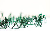 Green plastic soldiers, organized, white background isolated