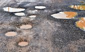 many hole on asphalt road in countryside in rainy season