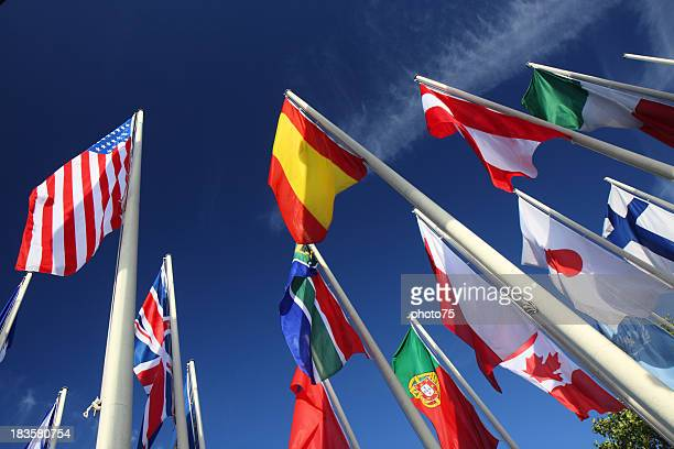 Many international flags on a pole