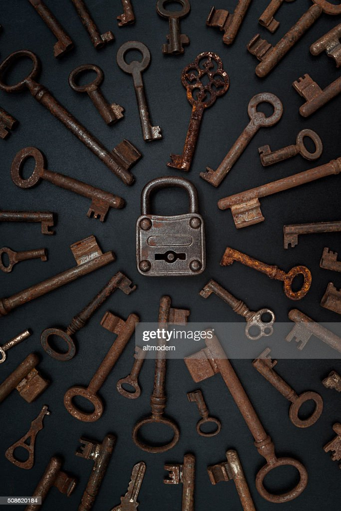 many keys on a blackboard with padlock : Stock Photo