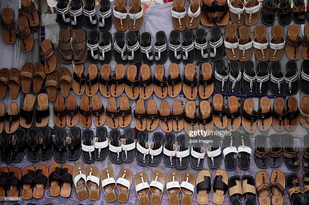 Many leather sandals on display at market. : Stock Photo
