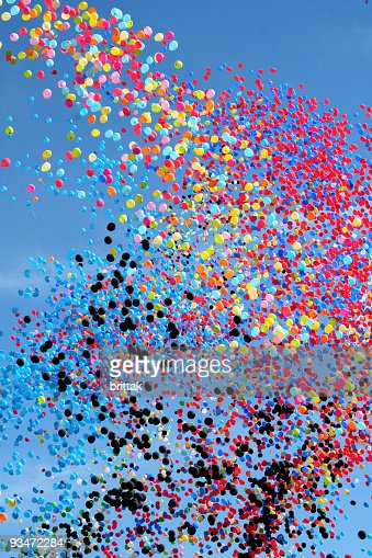 Many multi colored party balloons against the blue sky. Celebration.