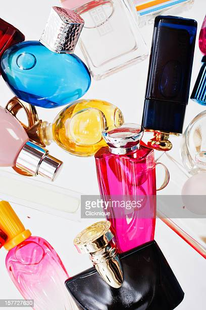 Many multi-colored miniature perfume bottle shot from overhead
