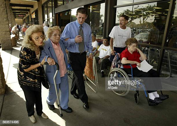 CITY CA Many people in line for flu vaccine Jaime Alexander Smith with Maxim healthcare Services who is giving the vaccine shots at Sav On is helping...