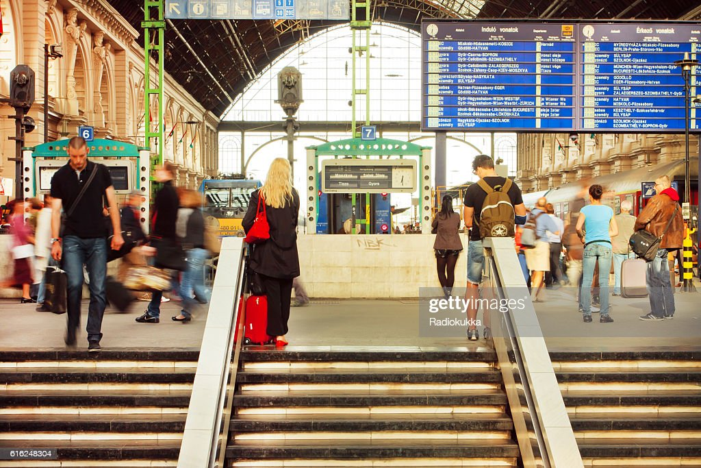Many people on stairs of railway station : Stock Photo