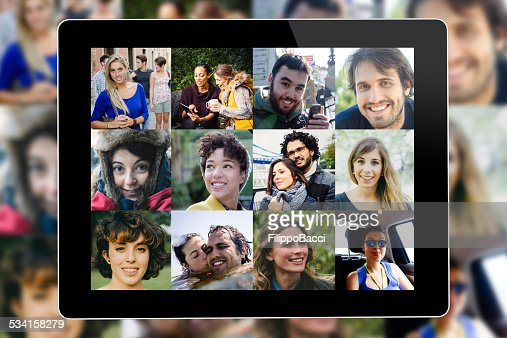 Many people portrait on a tablet screen : Stock Photo