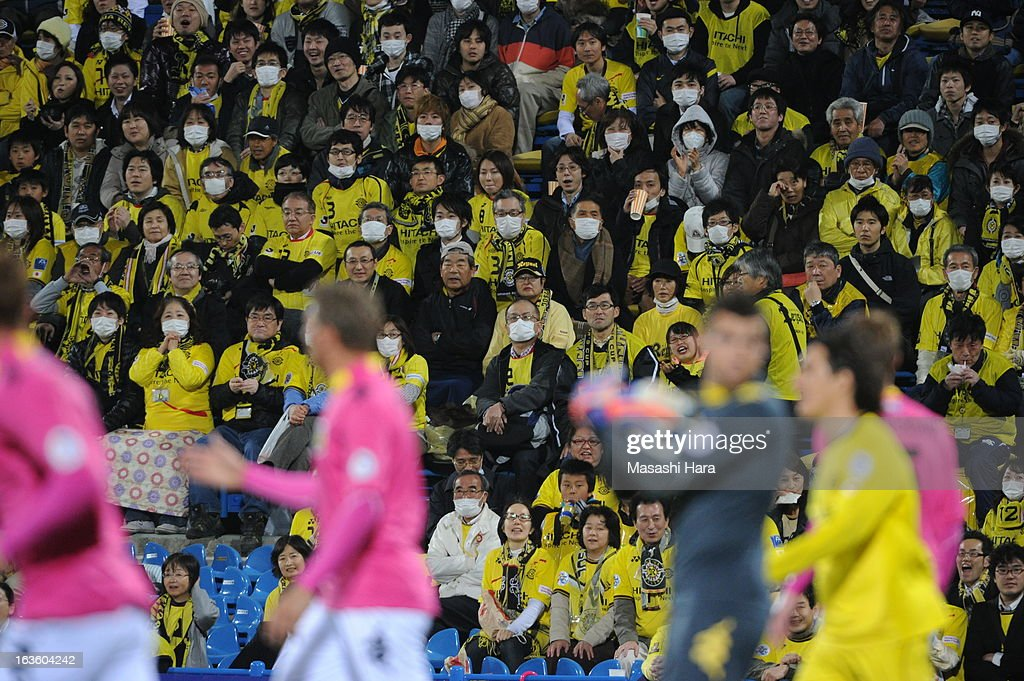 Many people wear mask during the AFC Champions League Group H match between Kashiwa Reysol and Central Coast Mariners at Hitachi Kashiwa Soccer Stadium on March 13, 2013 in Kashiwa, Chiba, Japan.