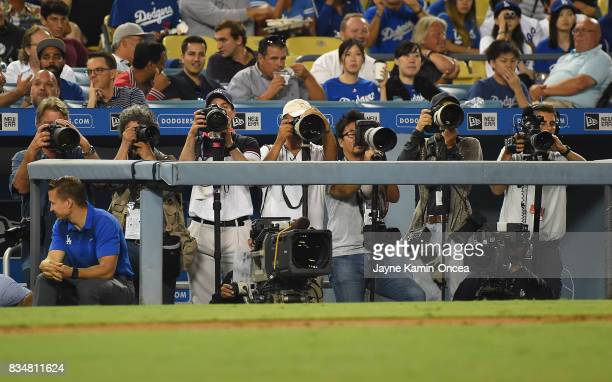 Many photographers were assigned to cover pitcher Yu Darvish of the Los Angeles Dodgers during his first home game against the Chicago White Sox at...