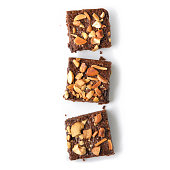 Many pieces of brownie on white background - isolated