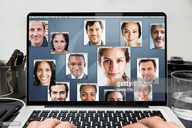Many portraits on laptop computer screen
