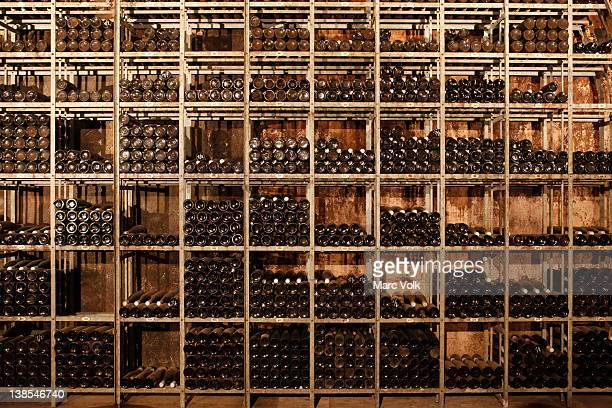 Many shelves of bottles of wine