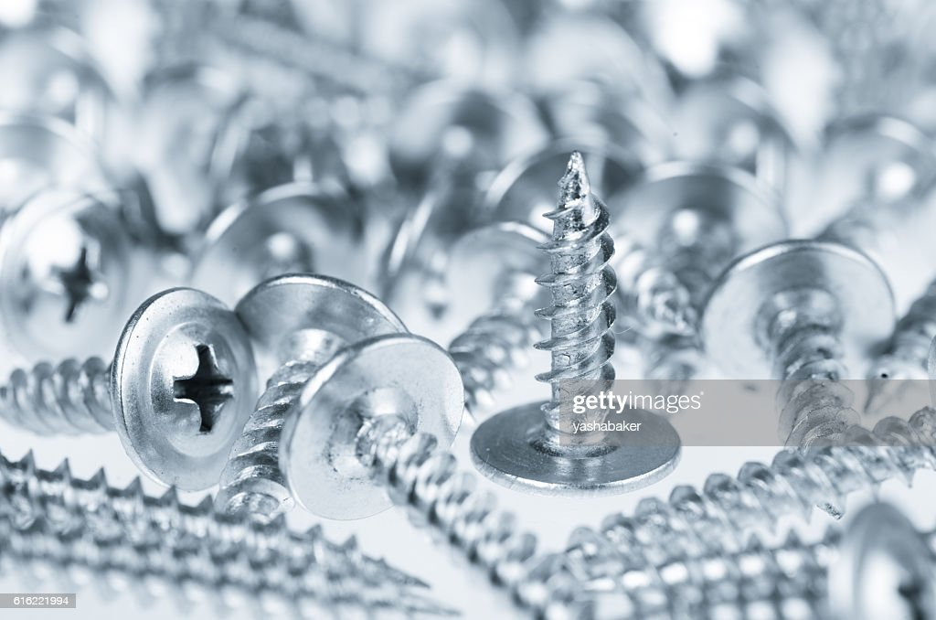Many silver screws toned grey : Stock Photo