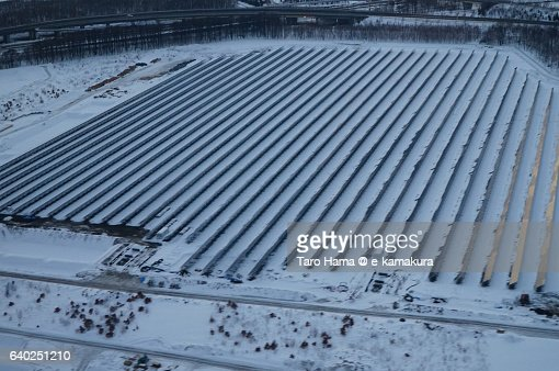 Many solar panels in snow city aerial view from airplane : ストックフォト