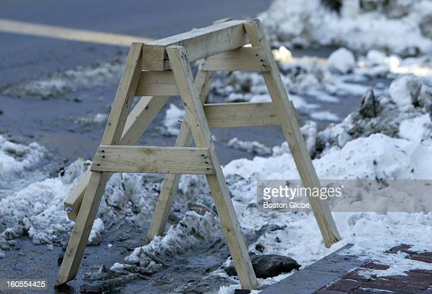 Many South Boston residents have left items located in parking spaces that they have removed snow from A saw horse holds a parking spot near F and...