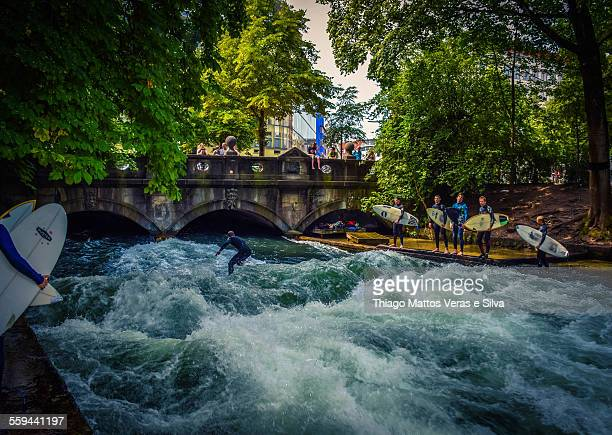 Many surfers in the Eisbach river Munich Germany