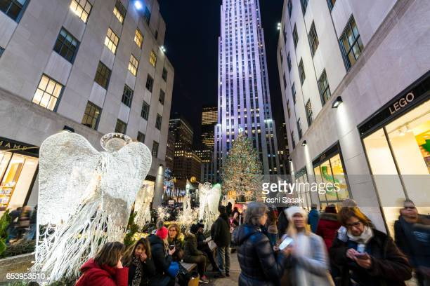 Many tourists are visiting to see the Rockefeller Center Christmas tree in Christmas Holidays Season 2016 New York at night. Rockefeller Center are decorated and illuminated for Christmas.