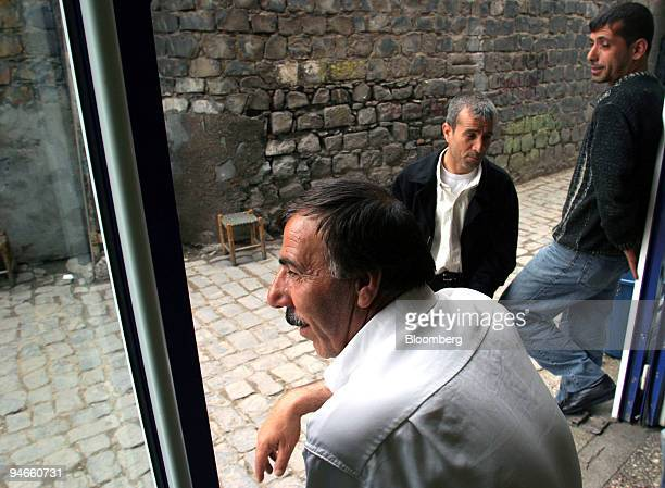 Many unemployed Kurdish men end up spending hours sipping tea playing cards or just sitting and chatting in tea houses in the back streets of the old...