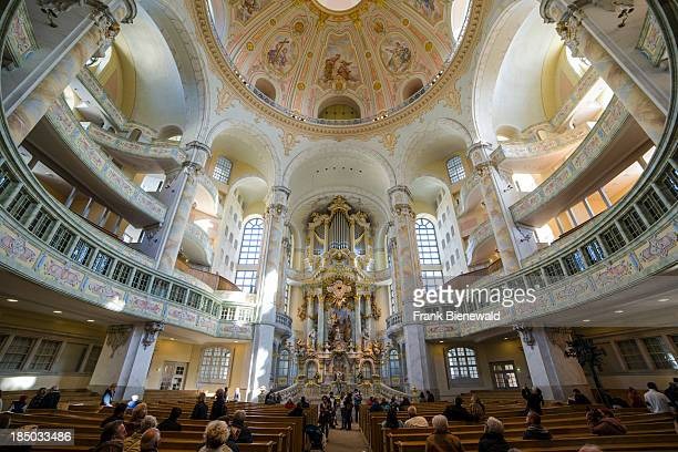 Many visitors are praying inside the church 'Frauenkirche'