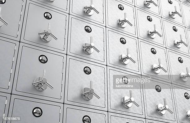 Many wall safes all with their doors closed and locked