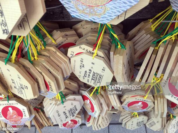 Many wooden plaques are hanging at Kawasaki daishi shrine in Kawasaki south of Tokyo Japan March 3 2017 Worshippers write their prayers or wishes on...
