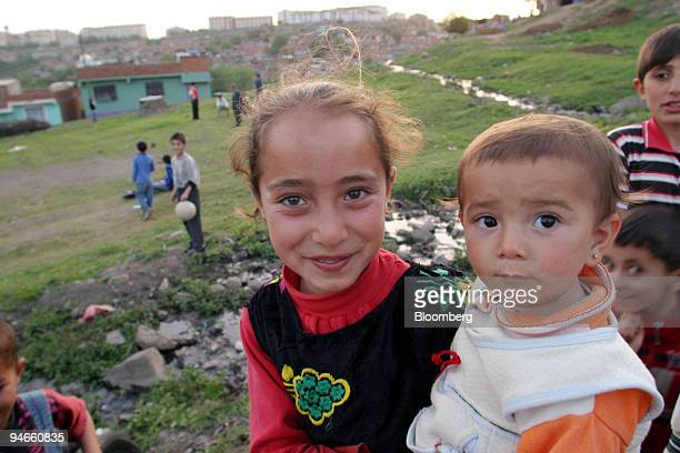 Many young Kurdish girls are left in charge of young babies while their parents try to make a living outside the city walls of the old town section...