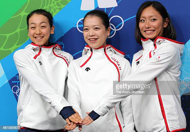 Mao Asada Akiko Suzuki and Miki Ando of Japan Figure Skating Ladies Singles team pose for photographs at a press conference during day nine of the...