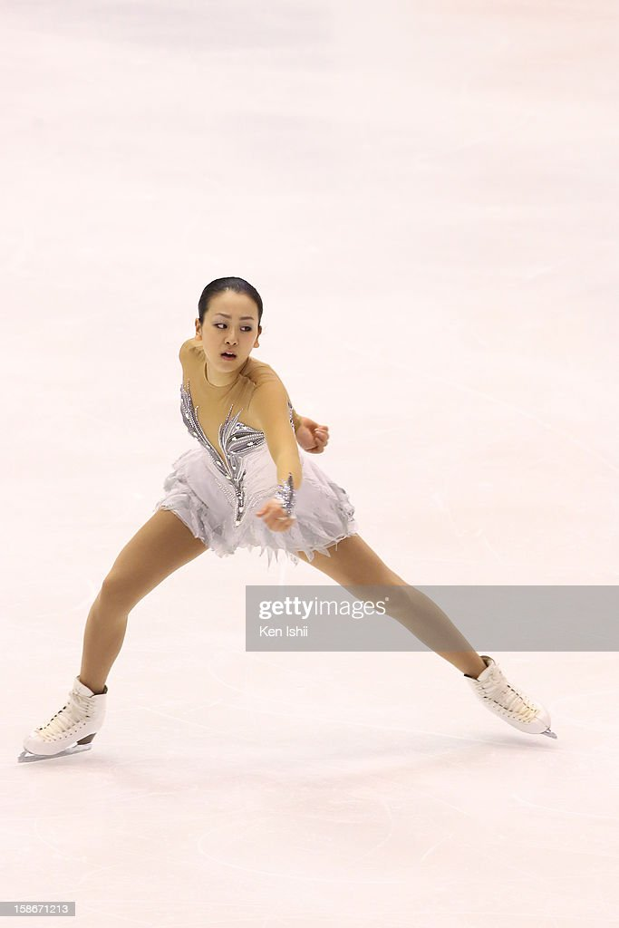 Mao Asada competes in the Women's Free Program during day three of the 81st Japan Figure Skating Championships at Makomanai Sekisui Heim Ice Arena on December 23, 2012 in Sapporo, Japan.