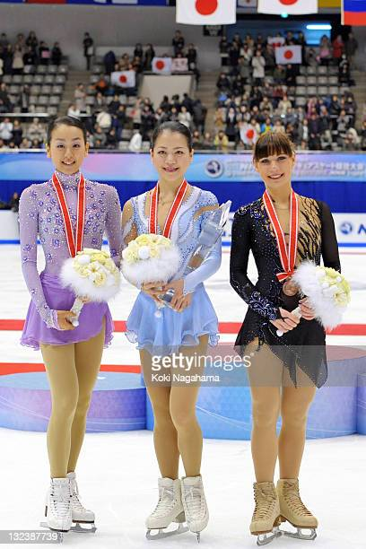 Mao Asada of Japan and Akiko Suzuki of Japan and Alena Leonova of Russia pose for photograghs during the women's singles on day two of the ISU Grand...
