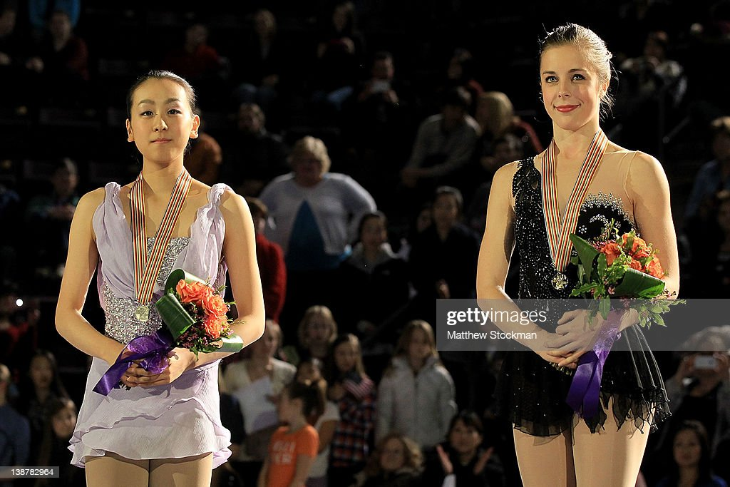 <a gi-track='captionPersonalityLinkClicked' href=/galleries/search?phrase=Mao+Asada&family=editorial&specificpeople=247229 ng-click='$event.stopPropagation()'>Mao Asada</a> of Japan and <a gi-track='captionPersonalityLinkClicked' href=/galleries/search?phrase=Ashley+Wagner&family=editorial&specificpeople=2564533 ng-click='$event.stopPropagation()'>Ashley Wagner</a> stand on the victory podium after the Ladies Competition during the ISU Four Continents Figure Skating Championships at World Arena on February 11, 2012 in Colorado Springs, Colorado.